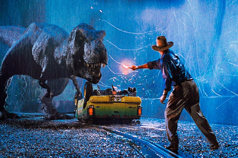 Sam Neill uses a flare to fend off a dinosaur as it rains in the dark.