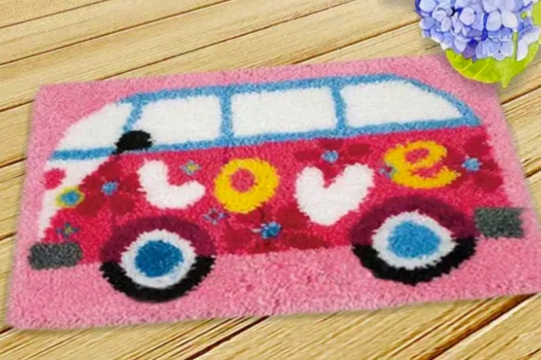 A rug with a bus that says love on the side.