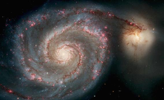 In this handout image released from the Hubble Space Telescope the Whirlpool Galaxy is seen , April 25, 2005 released for the Hubble 15th anniversary.