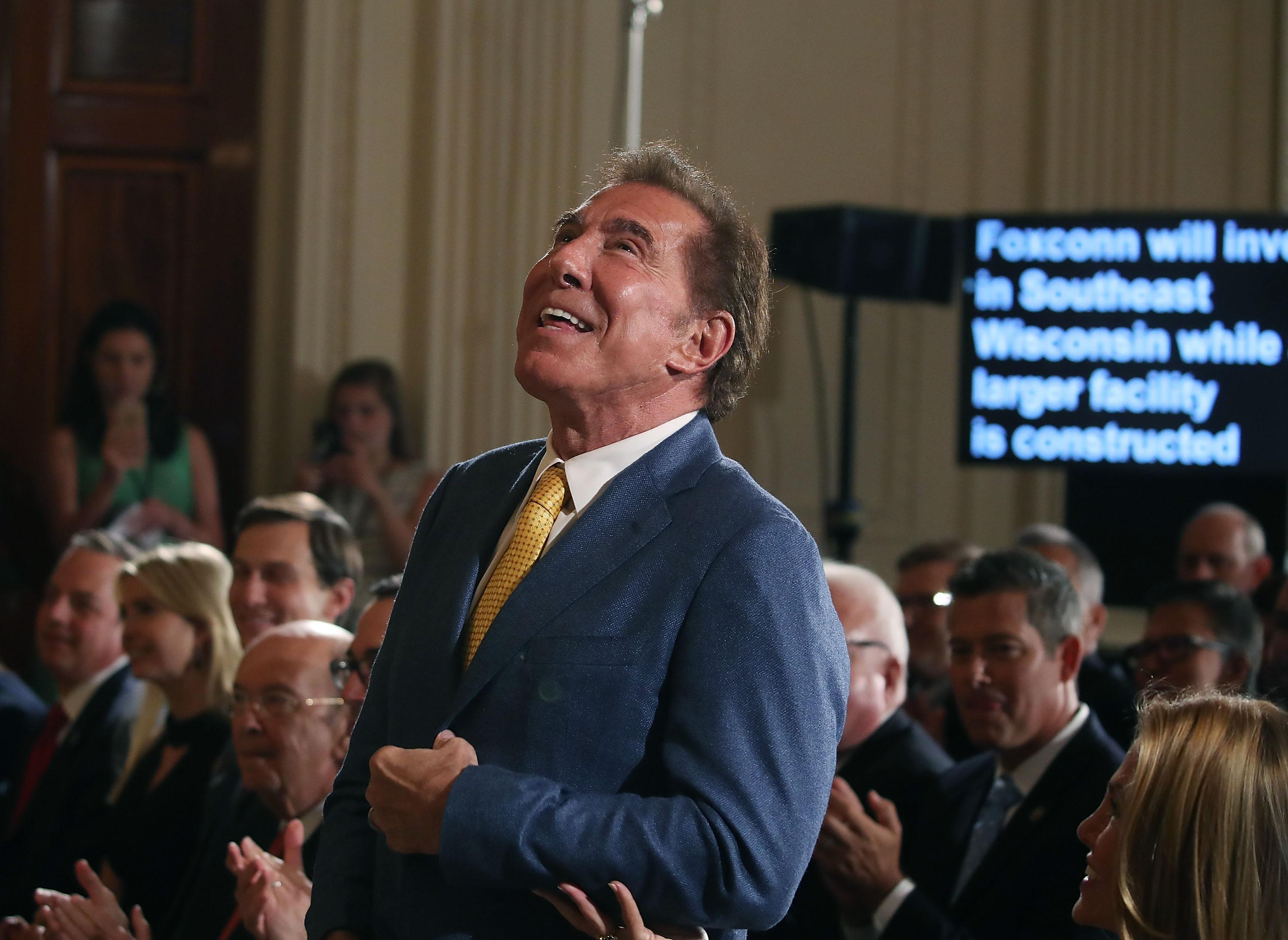 Steve Wynn, CEO of Wynn Resorts, is acknowledged at a news conference held by U.S. President Donald Trump in the East Room of the White House July 26, 2017 in Washington, DC. The president was touting a decision by Apple supplier Foxconn to invest $10 billion to build a factory in Wisconsin that produces LCD panels. Foxconn said the project would create 3,000 jobs, with the 'potential' to generate 13,000 new jobs, according to published reports.