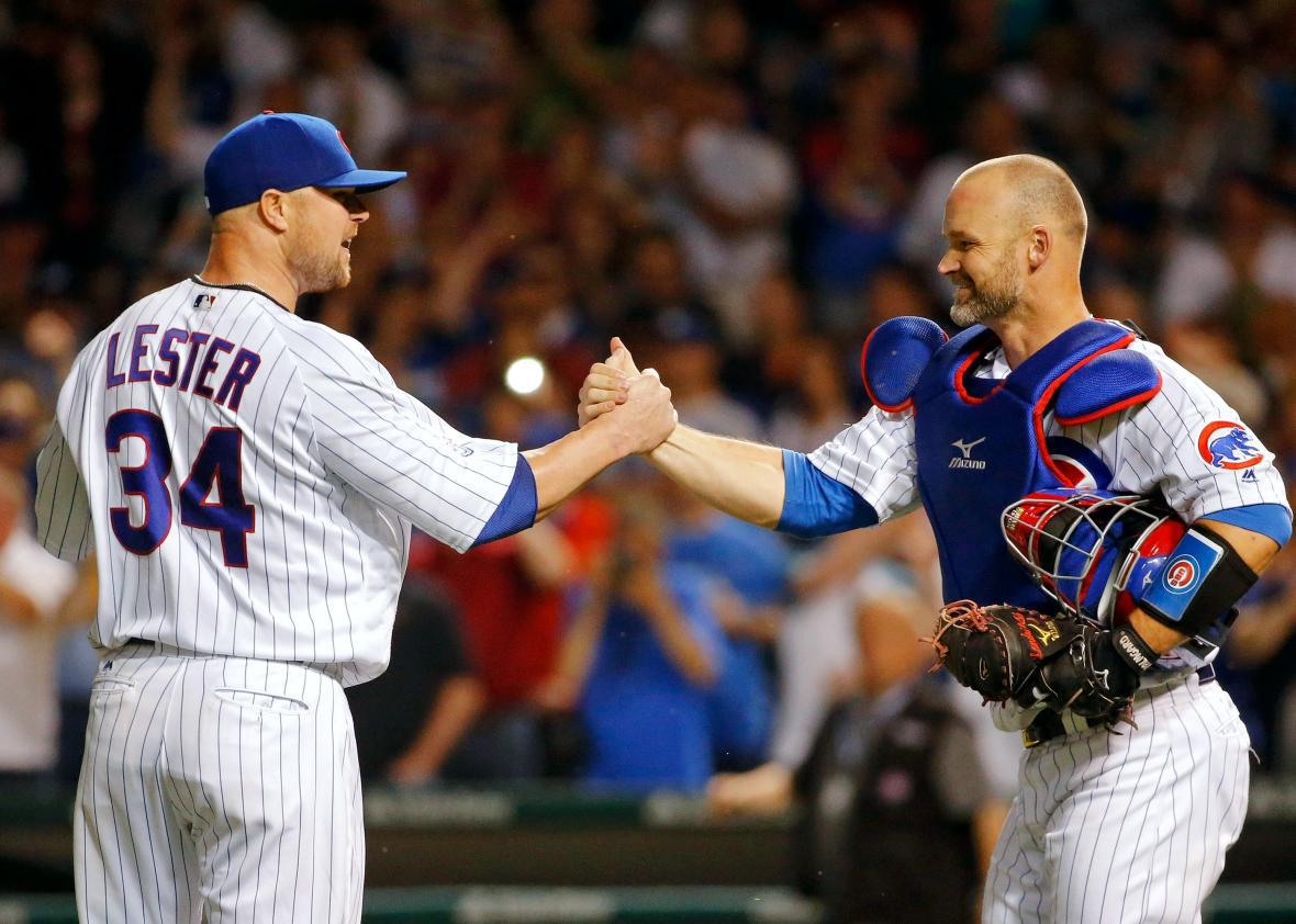 David Ross #3 of the Chicago Cubs congratulates Jon Lester #34