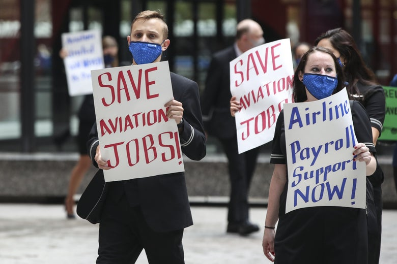 "Protesters hold up signs that say ""SAVE AVIATION JOBS"" and ""Airline Payroll Support Now!"""