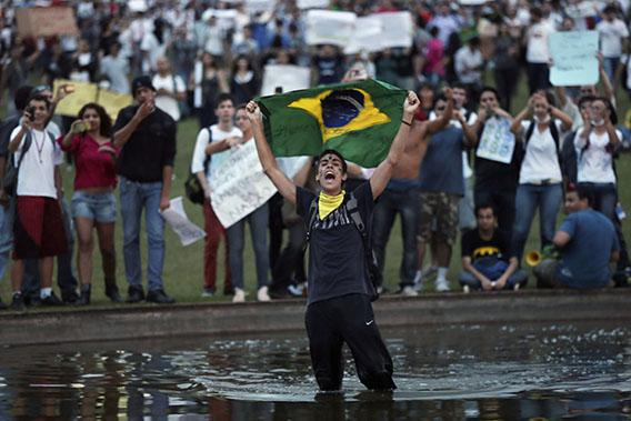 A demonstrator with the Brazilian flag protests against the Confederation's Cup and the government of Brazil's President Dilma Rousseff in Brasilia June 17, 2013.