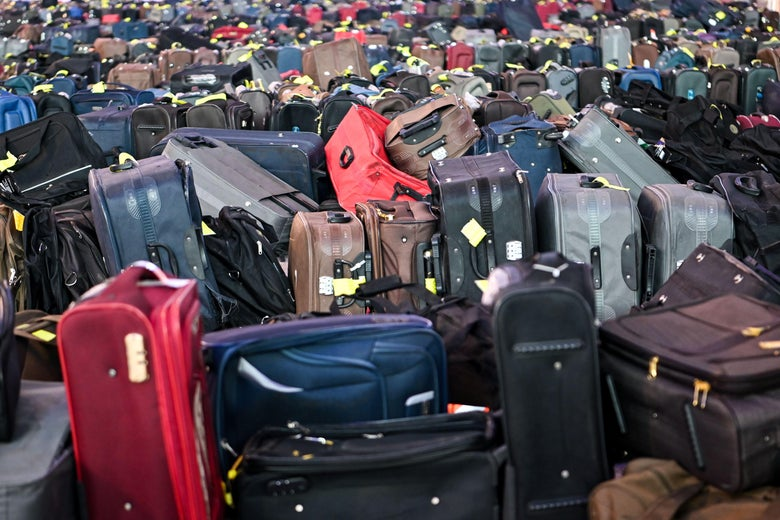 A large pile of suitcases