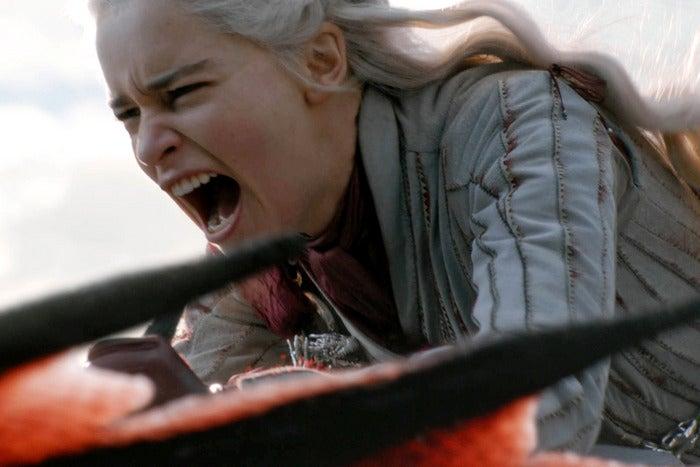 Daenerys Targaryen riding a dragon.