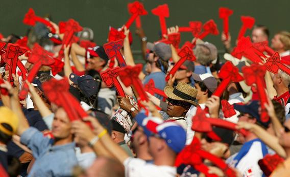 Fans of the Atlanta Braves do the Tomahawk Chop.