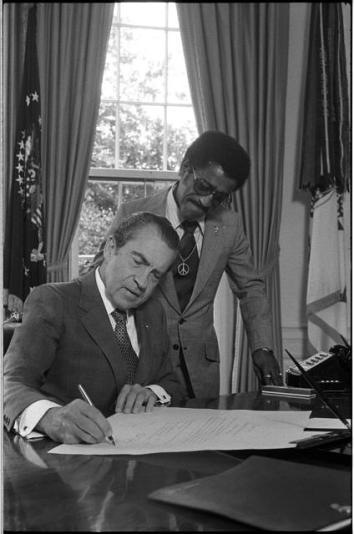 Pres. Nixon with Sammy Davis, Jr., new member of National Advisory Council on Economic Opportunity, July, 1971.