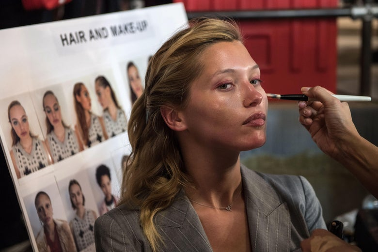 A model has make up applied backstage before the start of the Topshop catwalk show for the Spring/Summer 2018 collection on the third day of The London Fashion Week Women's in London on September 17, 2017.