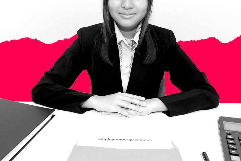 A woman at a desk conducting a job interview.