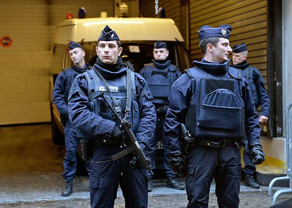 Police guard surviving editorial staff of Charlie Hebdo