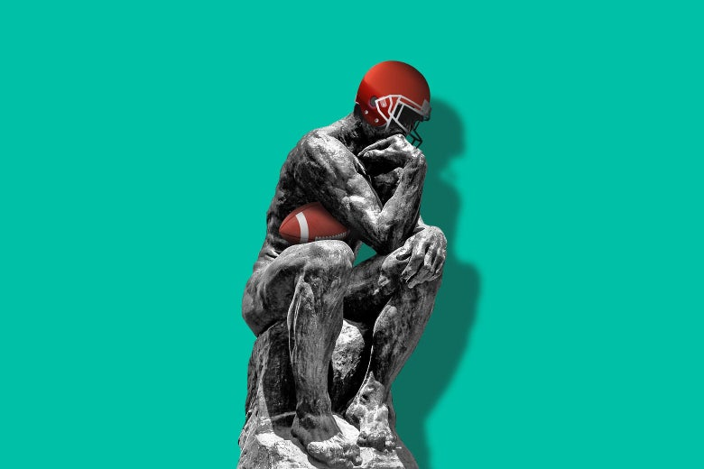 The Thinker wears a football helmet and cradles a football.