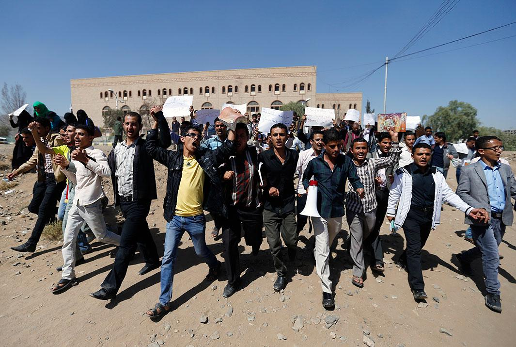 More students demonstrate against the Shiite Houthi movement's armed militia at Sanaa University campus in Sanaa, Yemen, on Nov. 12, 2014.