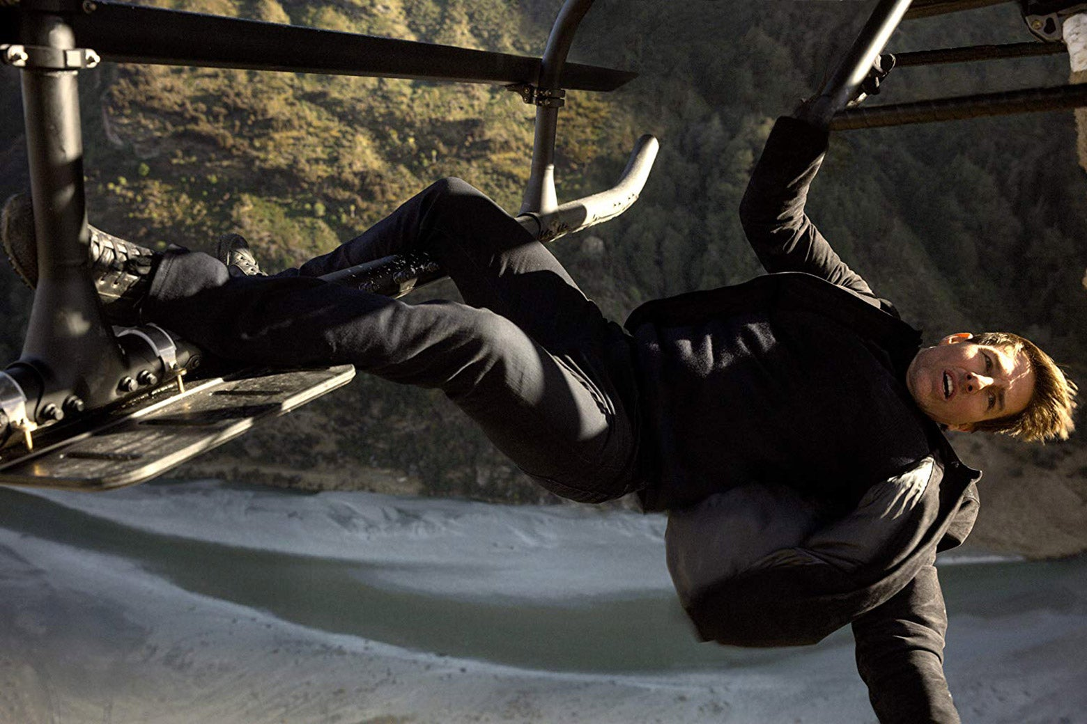 Tom Cruise hangs from a helicopter in Mission: Impossible—Fallout.