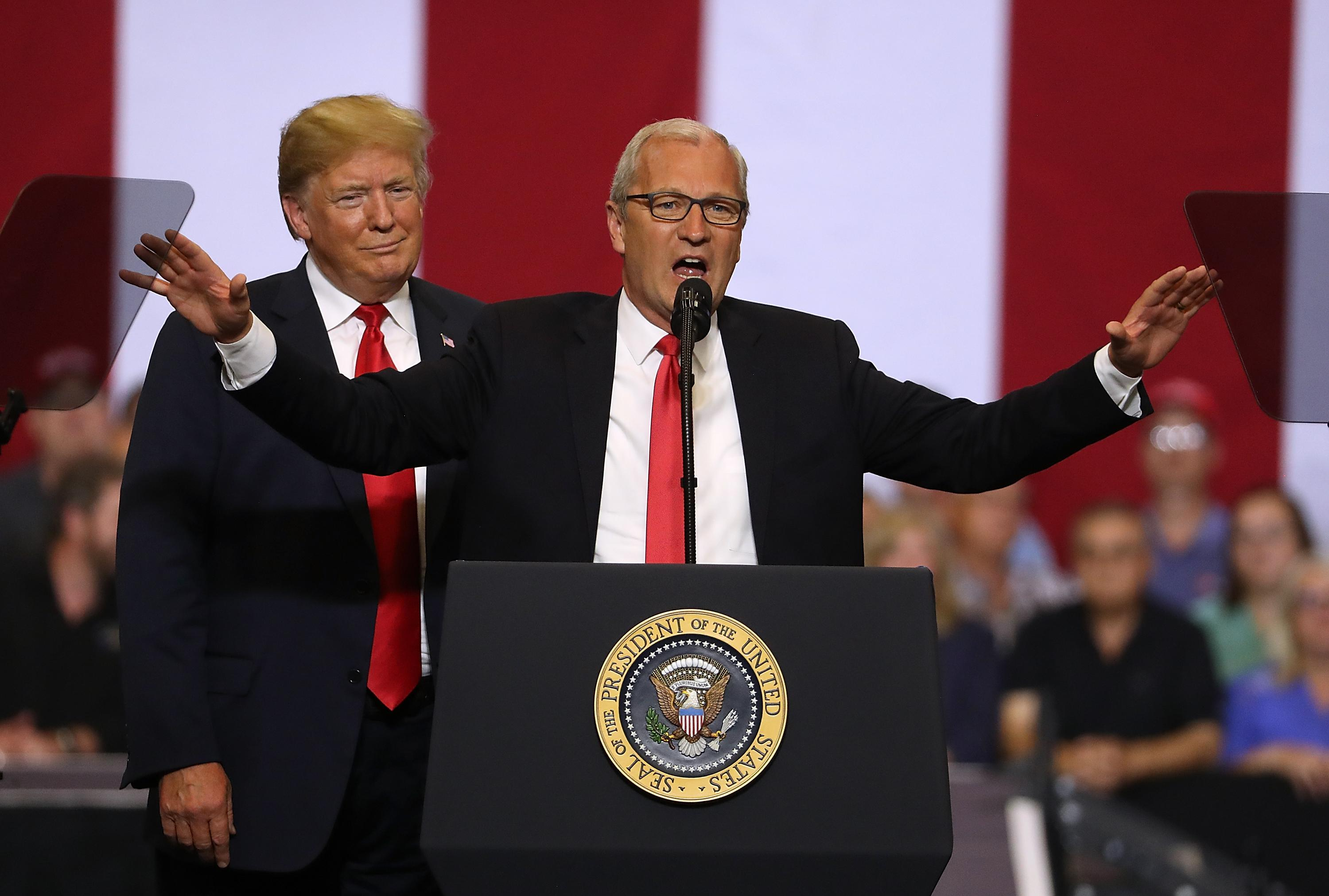 Donald Trump looks on as Kevin Cramer speaks at a June rally in Fargo, North Dakota.