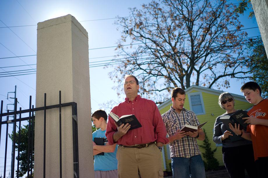 Matt Friedeman, a professor at Welsey Biblical Seminary, sings outside the clinic gates as women arrive for a counseling session in November 2012.