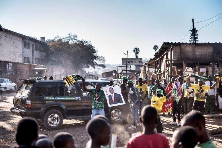Supporters of the newly reelected Zimbabwe President Emmerson Mnangagwa celebrate in Harare on August 3, 2018.