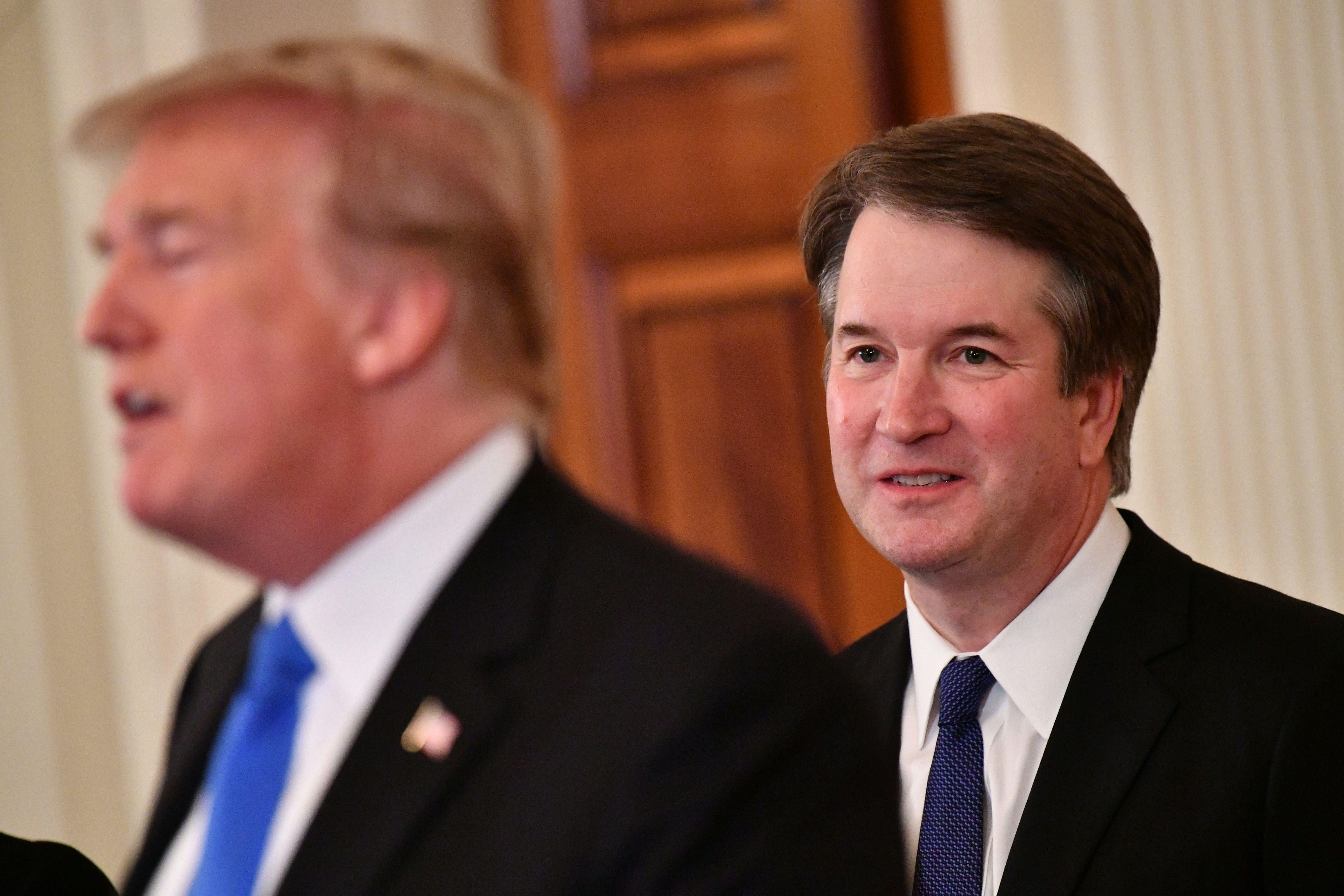 Supreme Court nominee Brett Kavanaugh listens to U.S. President Donald Trump announcing his nomination in the East Room of the White House on July 9, 2018 in Washington, DC. (Photo by MANDEL NGAN / AFP)        (Photo credit should read MANDEL NGAN/AFP/Getty Images)