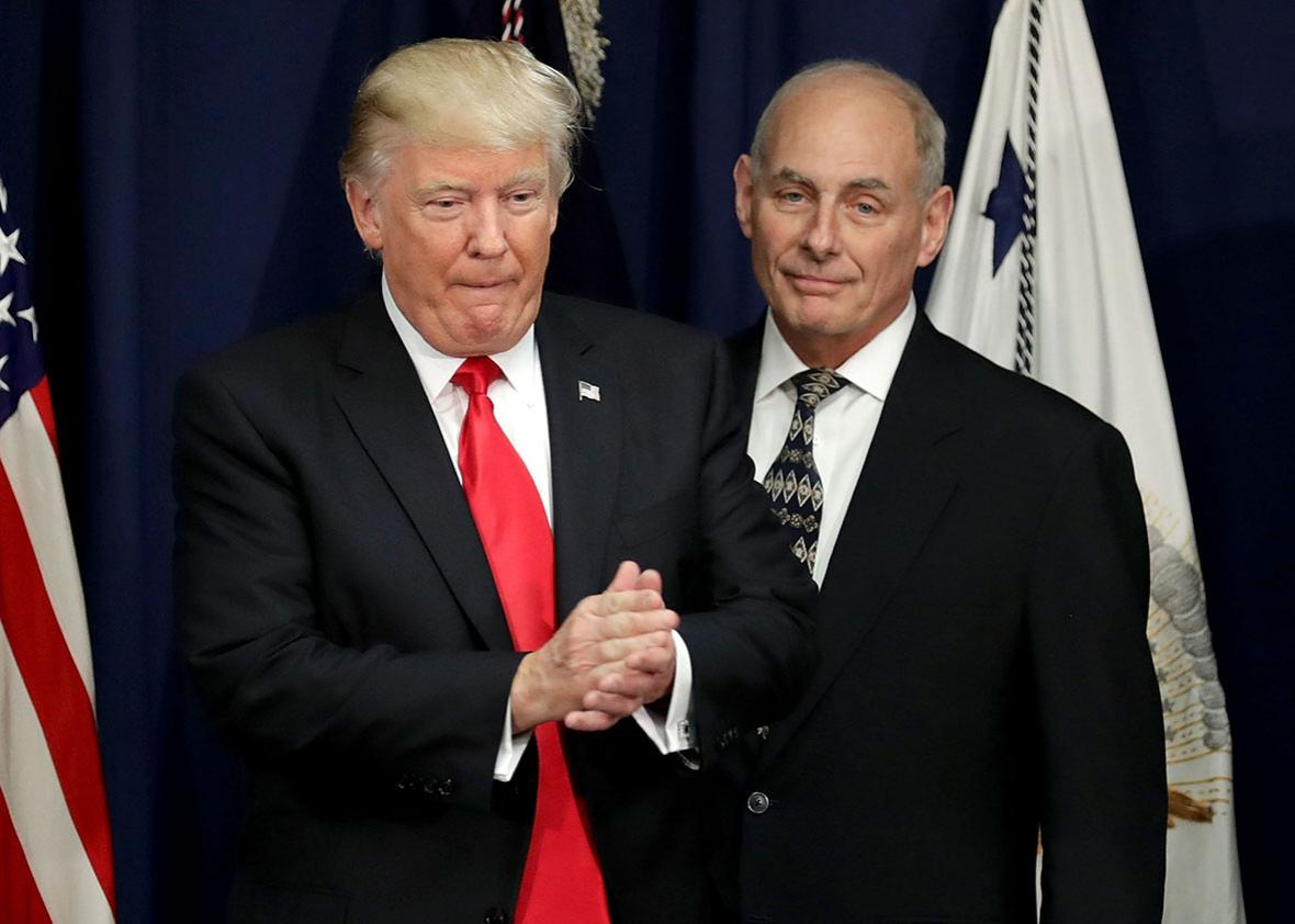 U.S. President Donald Trump is joined by Homeland Security Secretary John Kelly during a visit to the Department of Homeland Security January 25, 2017 in Washington, DC.