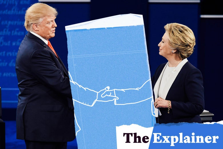 Donald Trump and Hillary Clinton shake hands at a debate.