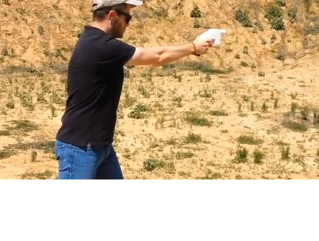 "Cody Wilson fires his 3-D printed gun, dubbed ""Liberator."""