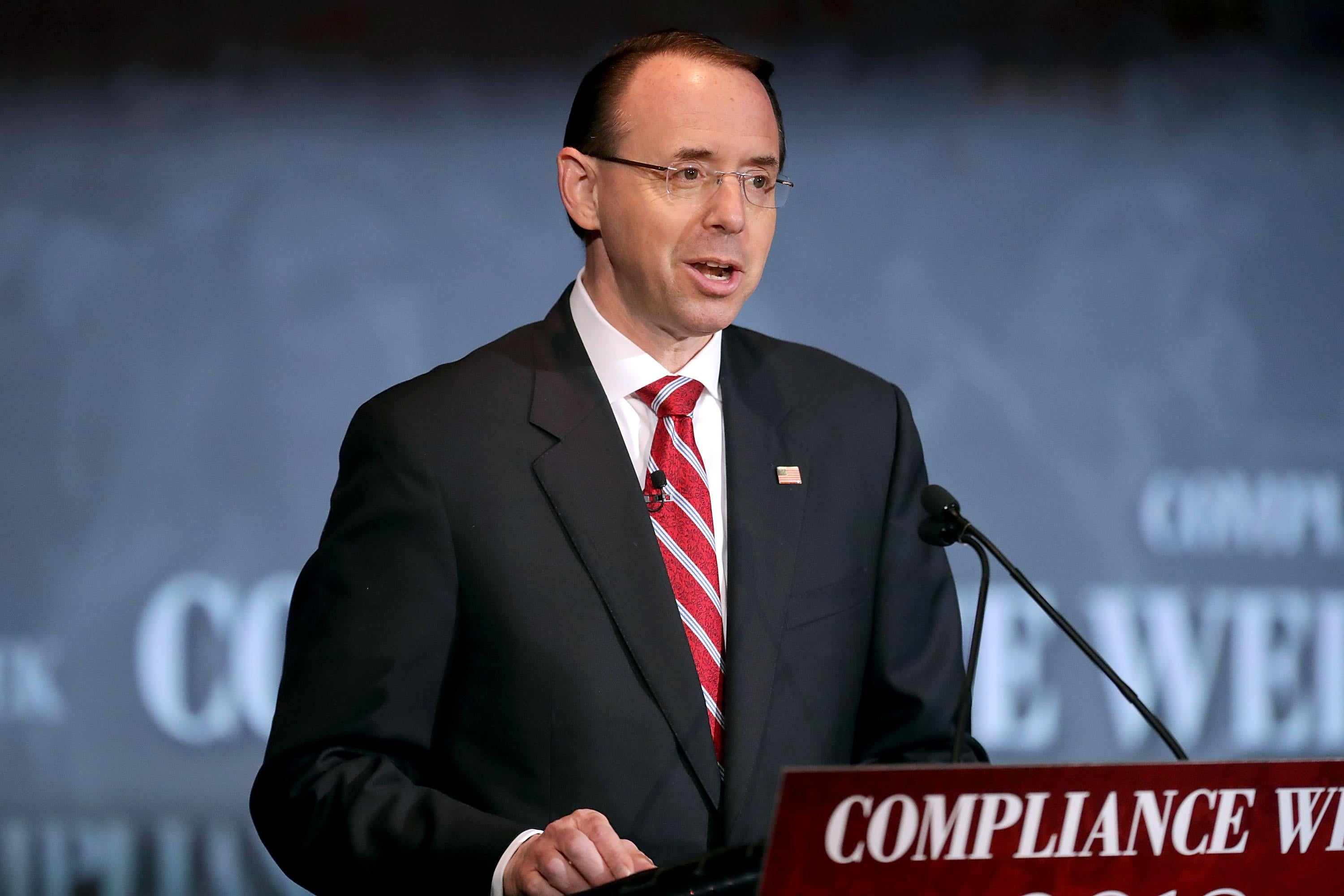 Rod Rosenstein stands at a podium.