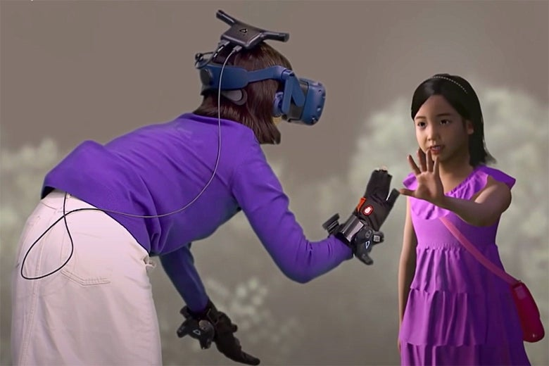 A woman in a headset and gloves reaches out to touch the hand of a young girl.