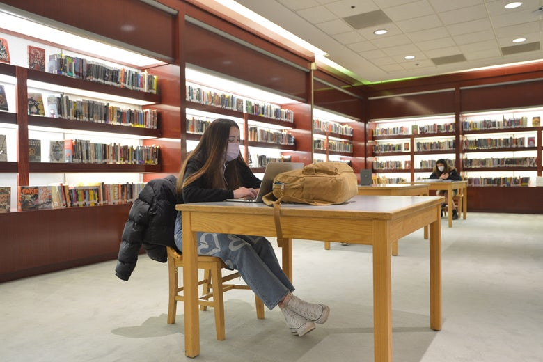 Backlit display shelves highlight reading in way not previously utilized. The area was the perfect location for Burlington High School's library when it transitioned to its temporary space in a former Macy's department store in downtown Burlington