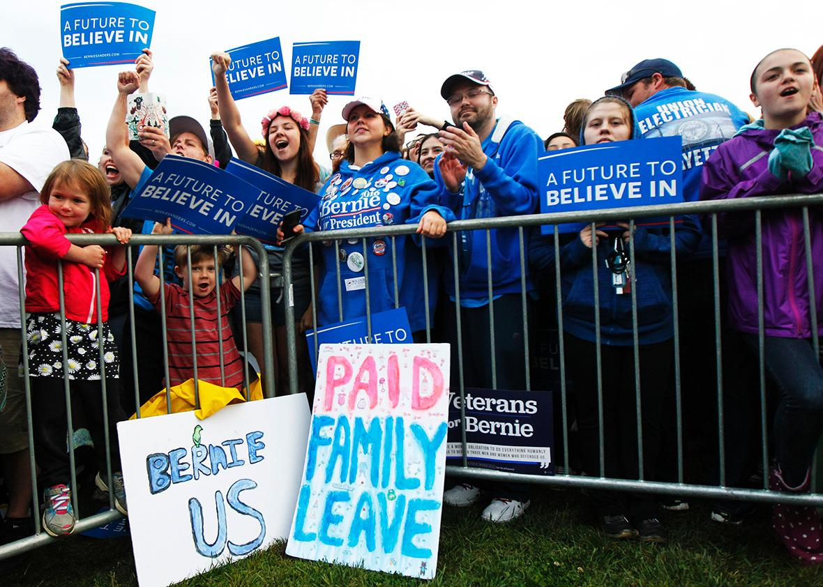 Campaign supporters show their support for Democratic presidential candidate Bernie Sanders as he speaks to them during a campaign rally at the Big Four Lawn park May 3, 2016 in Louisville, Kentucky.