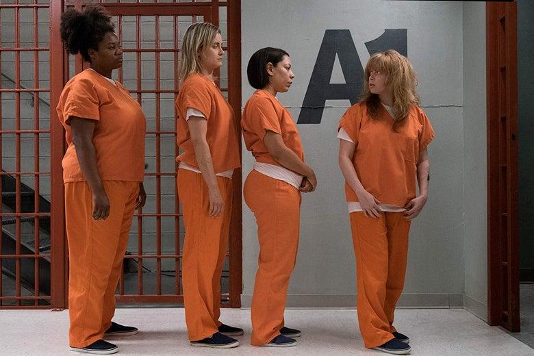 Natasha Lyonne, Selenis Leyva, Taylor Schilling, and Adrienne C. Moore stand in a line in orange prison attire.