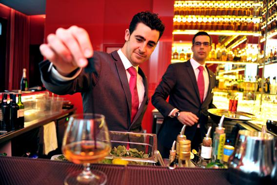 A barman works at the Hotel Radisson Blu in February 8, 2013 in Nantes, western France.