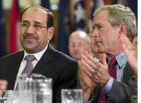 George W. Bush and Nuri al-Maliki. Click image to expand.