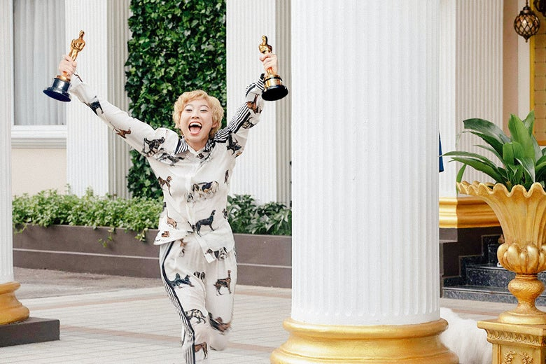 Photo illustration of Awkwafina in Crazy Rich Asians, but she's dual-wielding Oscar trophies.