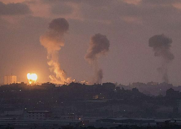 Israeli border with the Gaza Strip shows smoke billowing during an Israeli air strike in the Palestinian.
