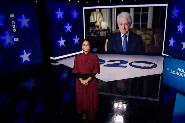 Bill Clinton looming over Tracee Ellis Ross's shoulder on a screen.