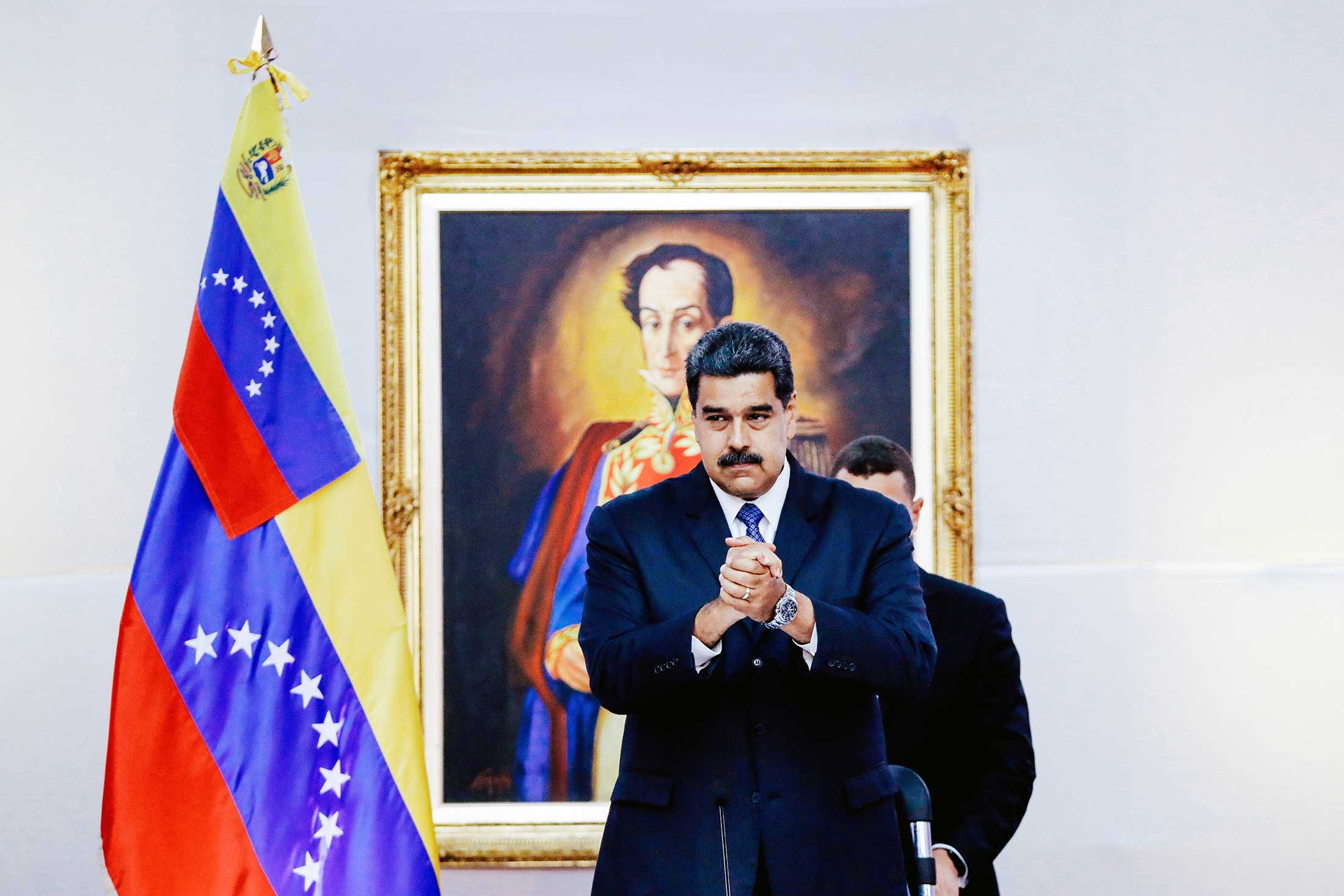 Venezuela President Nicolás Maduro greets international observers for the election at the presidential palace in Caracas, Venezuela, on Friday.