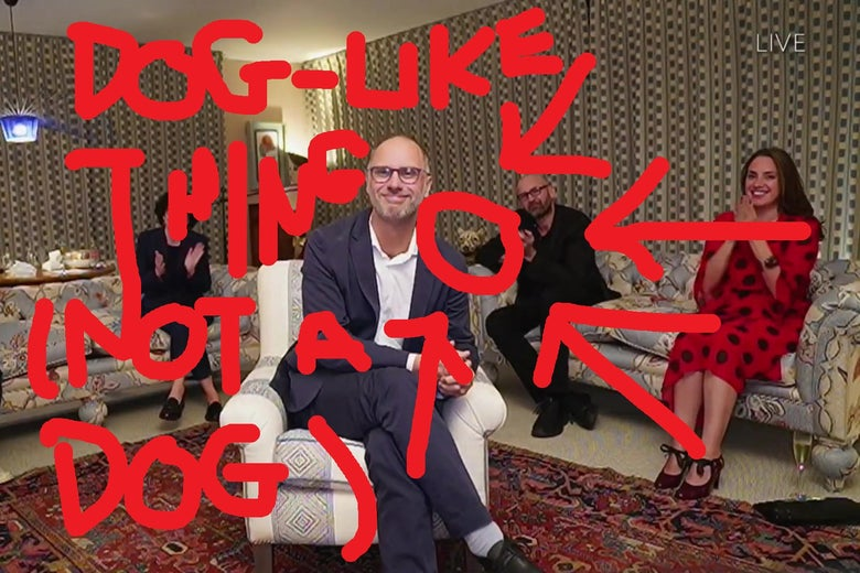 The same shot of Jesse Armstrong in a living room, but the head of a dog sculpture behind one of the couches has been pointed out with bright red arrows.