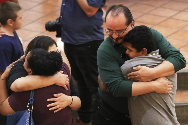 People embrace at the vigil.