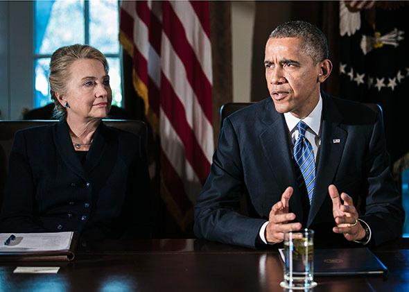 U.S. President Barack Obama (R) speaks as U.S. Secretary of State Hillary Clinton listens at a cabinet meeting at the White House on November 28, 2012 in Washington, DC.