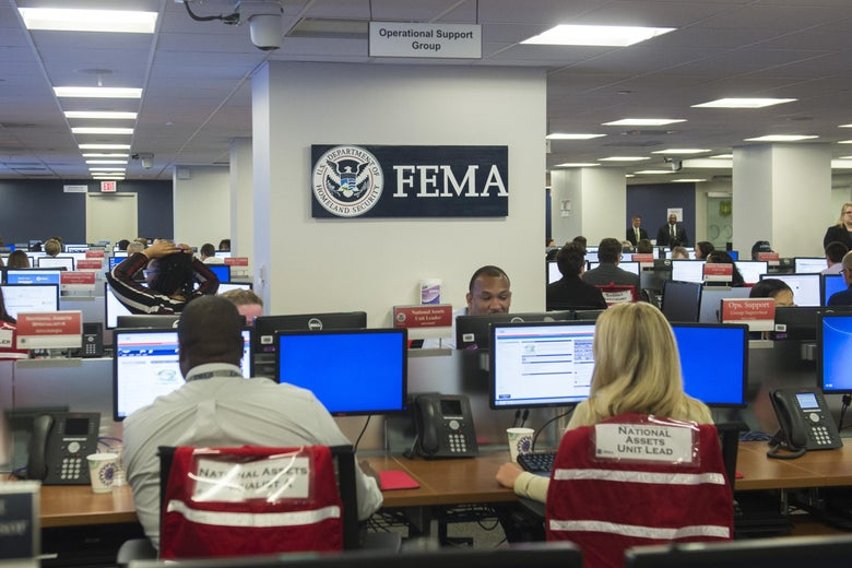 Employees work on computers inside the FEMA Command Center.