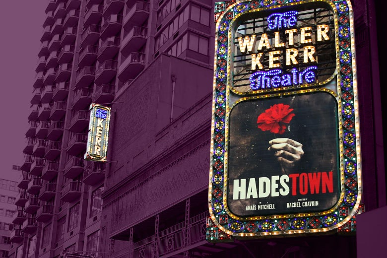 Hadestown on the marquee outside the theater, with a high-rise in the background