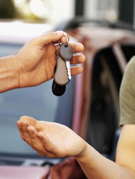 Handing off car keys.