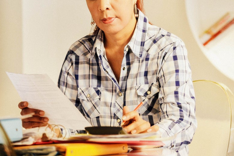 Stock image of a person looking over paperwork.