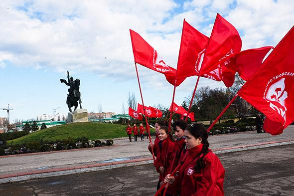 Young members of the communist party march on the 96th anniversary of the Russian Revolution. Tiraspol, Moldova