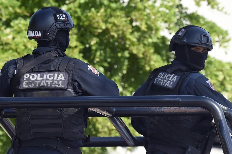 Policemen stand guard in the area where heavily armed gunmen waged an all-out battle against Mexican security forces in Culiacan, Sinaloa state, Mexico, on October 18, 2019.