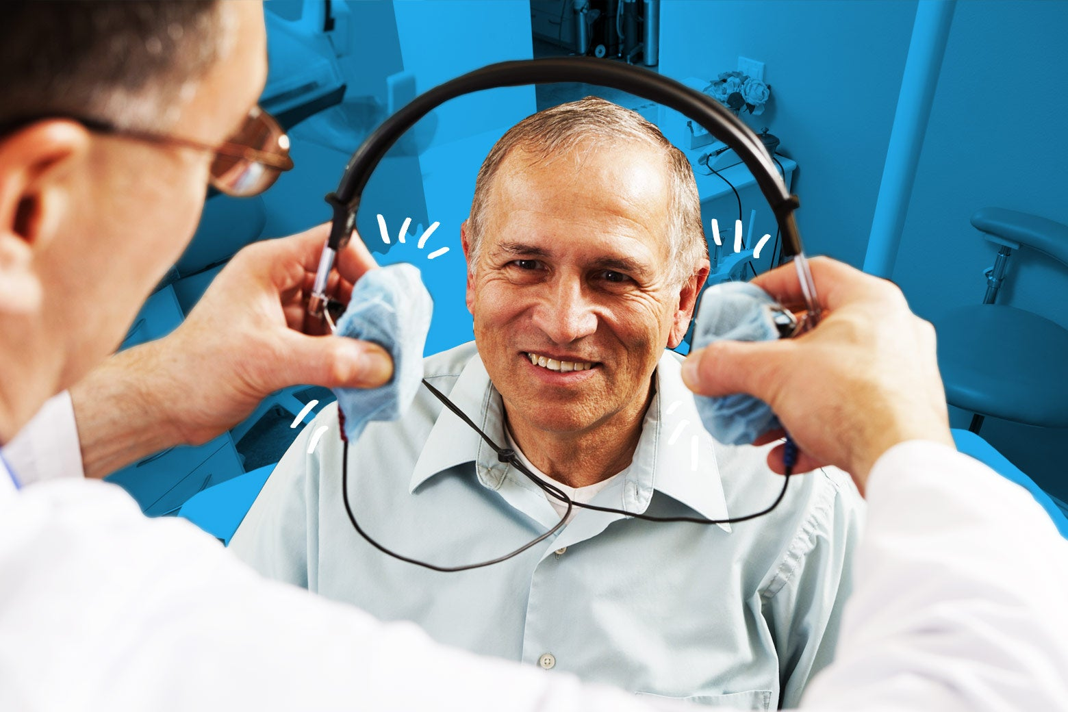 A dentist presents a patient with headphones.