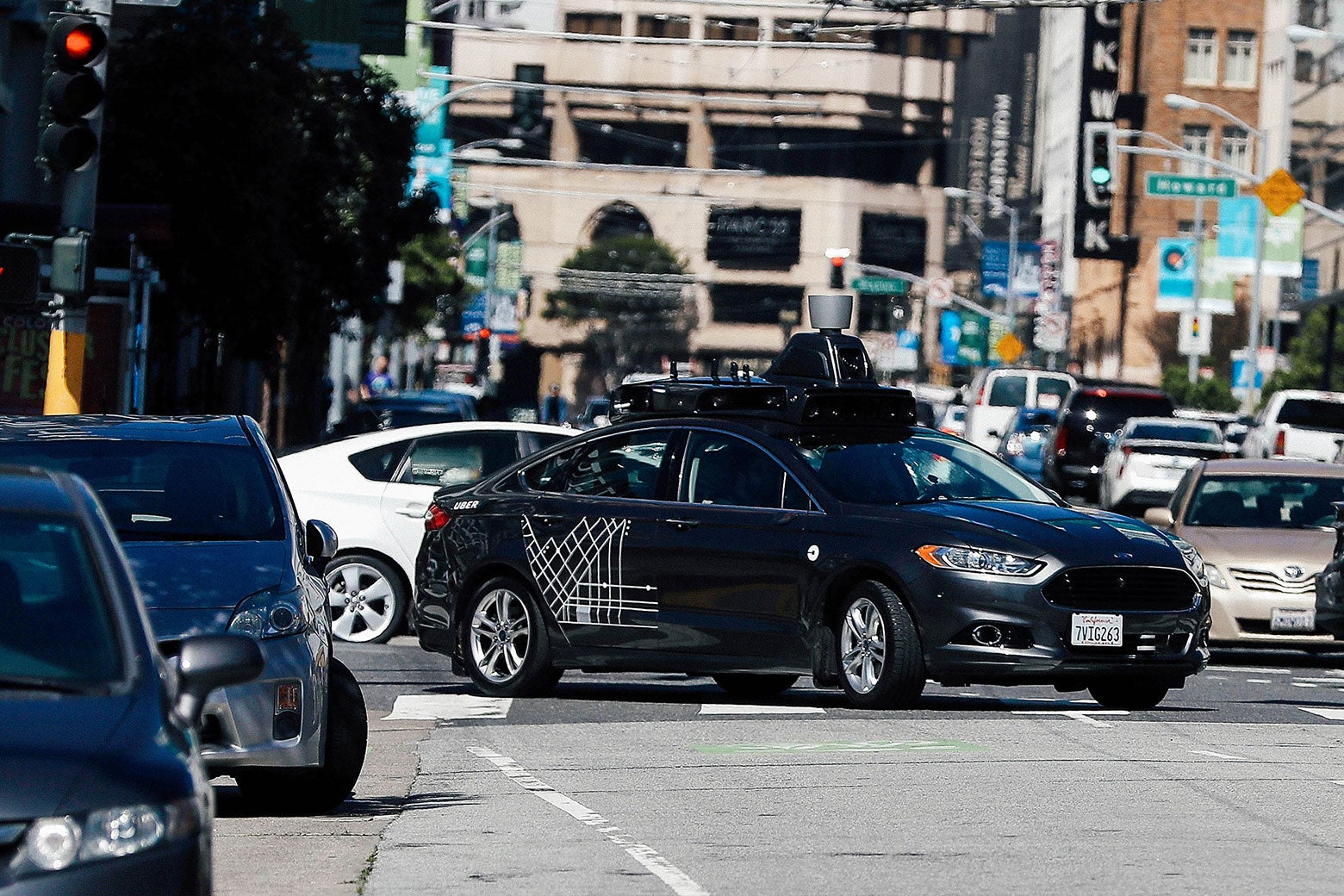 An Uber self-driving car drives down Fifth Street in San Francisco.