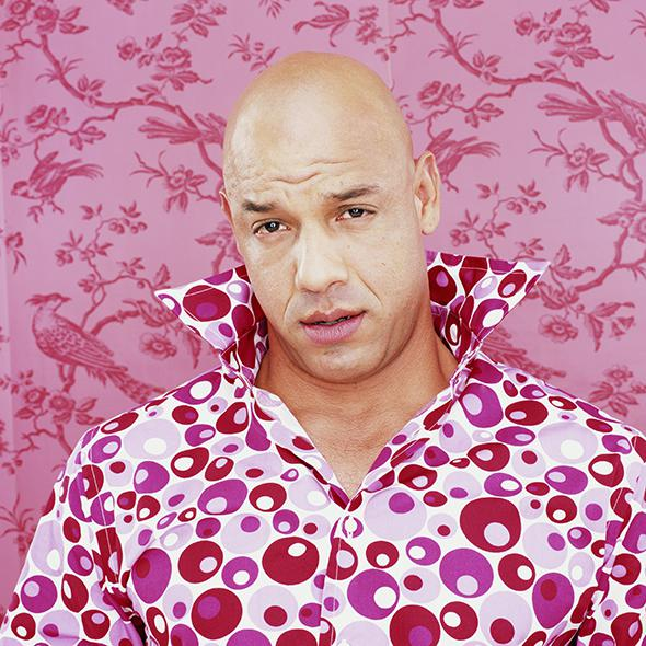 Bald man wearing patterned shirt, portrait