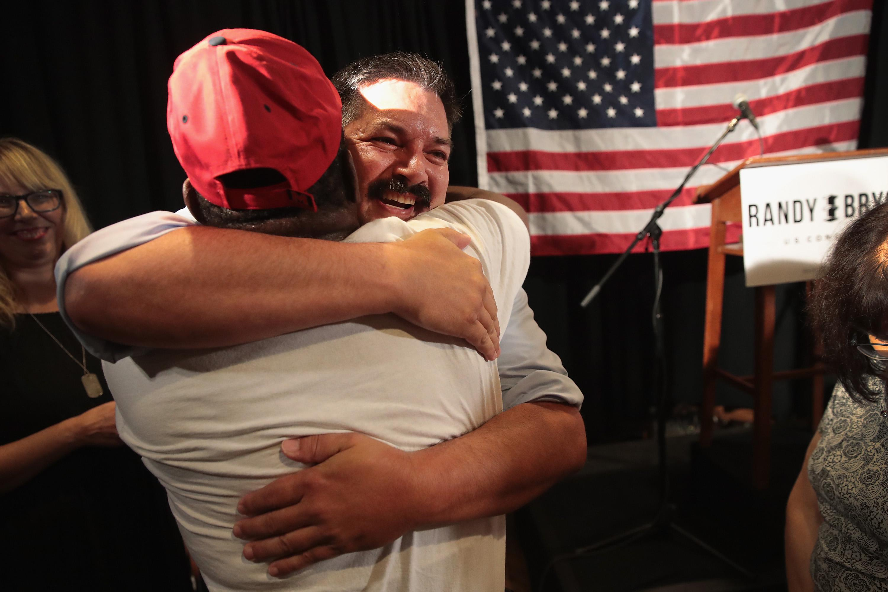 Randy Bryce hugs a supporter at an election-night rally.