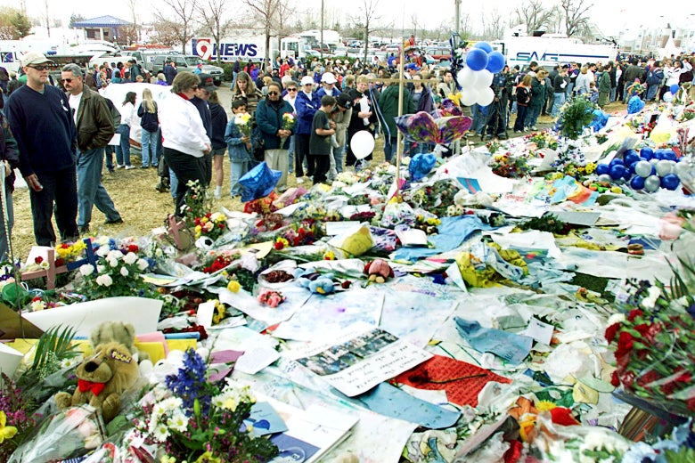 Littleton residents gather at the Clemment Park memorial on Apr 24, 1999 to pays respects to twelve students and one teacher who died at Columbine High School following a shooting by two students.