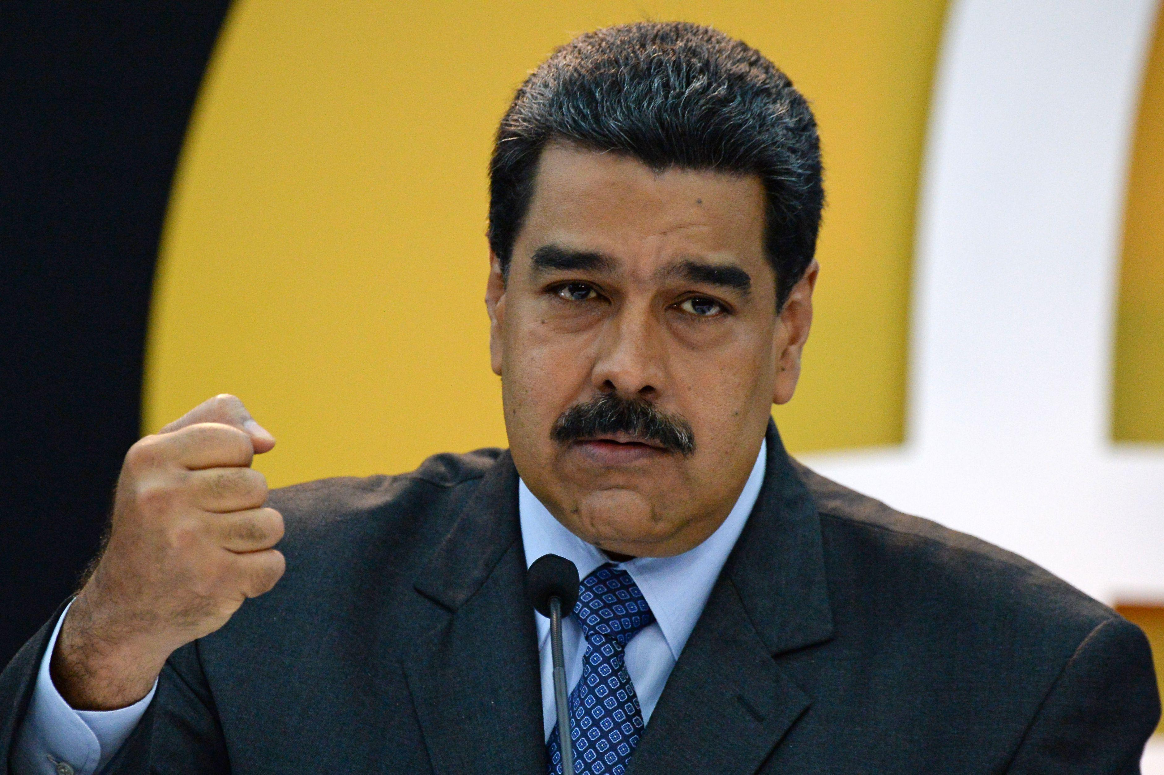"""Venezuela's President Nicolas Maduro during a press conference to launch to the market a new oil-backed cryptocurrency called """"Petro."""""""